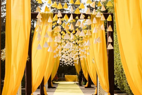 Cascading florals & drapes for entrances